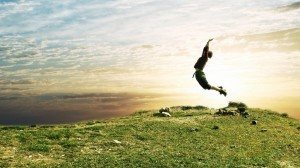 nature_grass_people_jump_sky_1366x768_37510