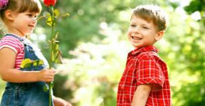 stock-footage-two-children-speaking-and-boy-present-flower-860x450_c