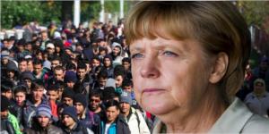 merkel-migrants-696x348