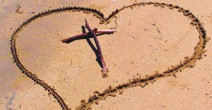 Cross-and-Heart-in-Sand-610x350-860x450_c