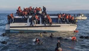 migrants-1-696x400