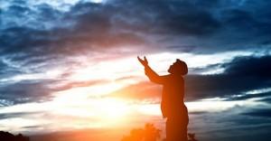 silhouette-of-handsome-man-praying_1150-861-696x398-860x450_c