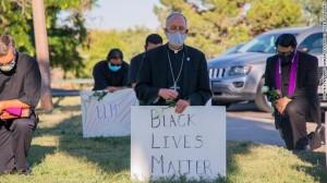 el-paso-diocese-kneels-bishopMarkSeitz